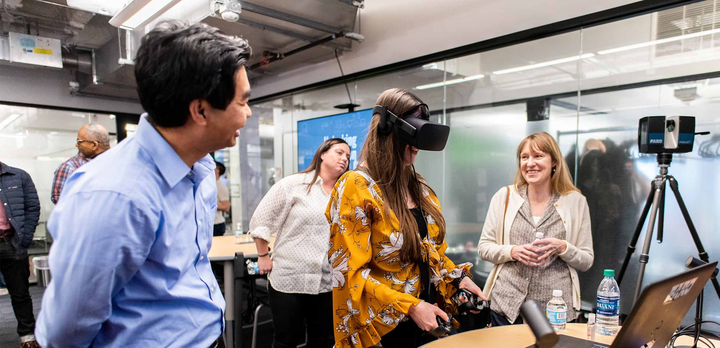 Ideation Lab visitors try on a virtual reality head set